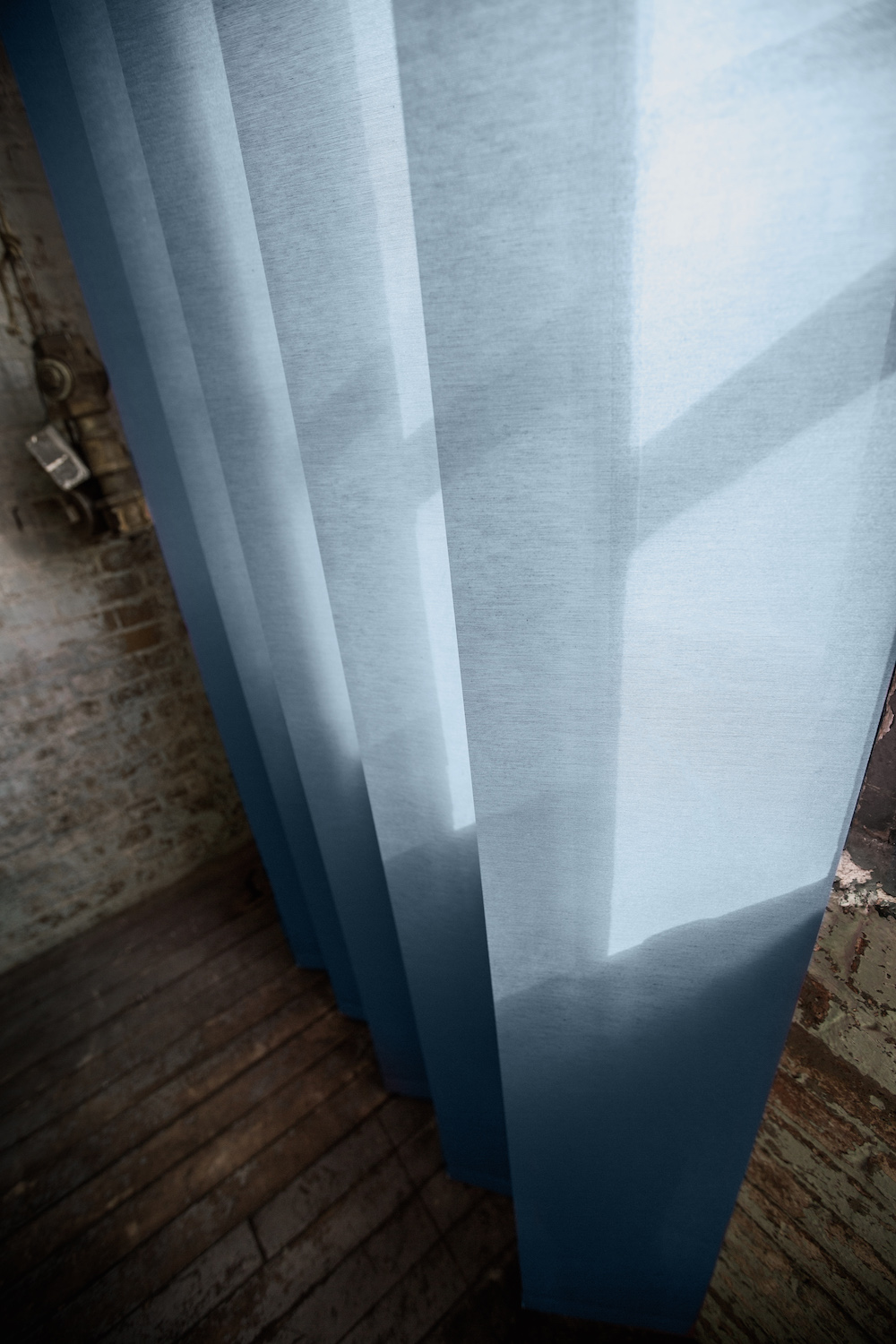 Install XL vertical blinds in your summer bedroom to channel the open ocean.