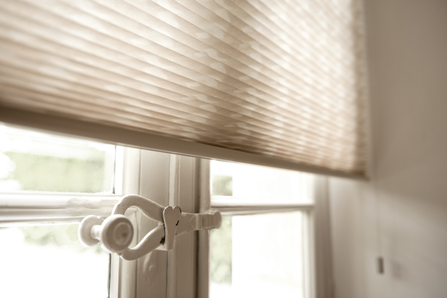 Cellular Shades are stylish but functional because of their ability to insulate temperature. Perfect for a summer bedroom.