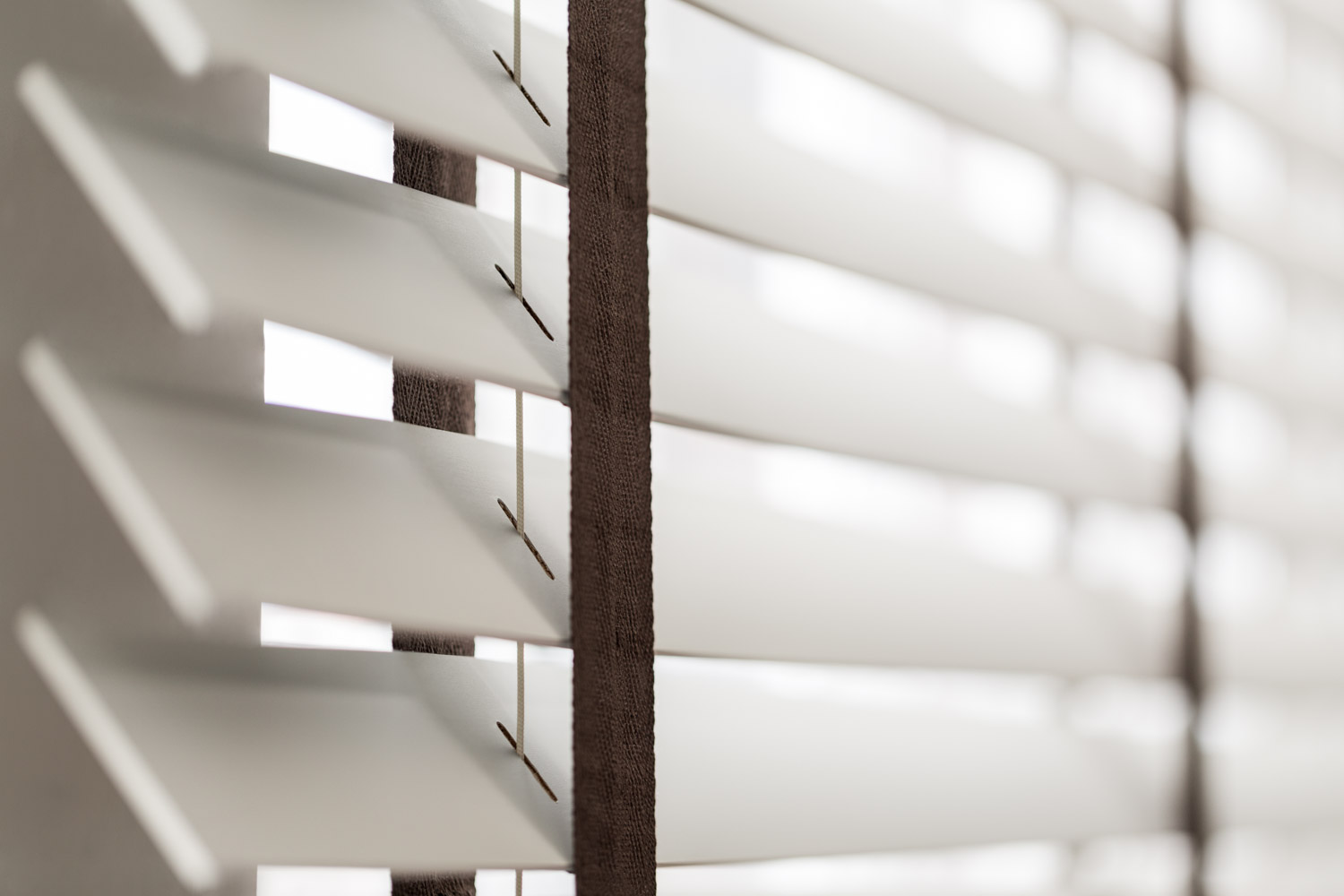 Faux Wood Blinds Are Extremely Durable For Your Bathroom.