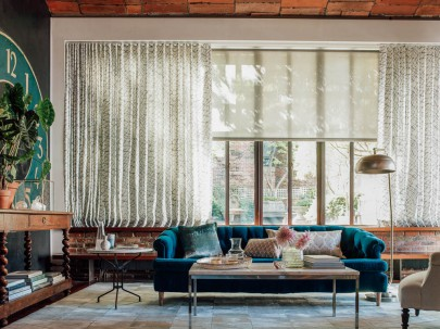 Solar shades and Drapery on Living Room Windows by The Shade Store