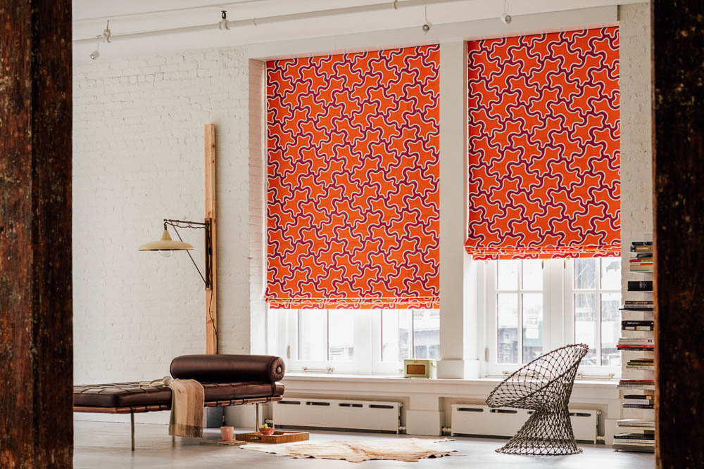 Designer Flat Roman Shades on Living Room Windows by The Shade Store