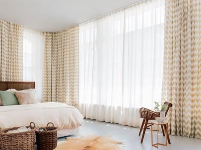 Layered bedroom drapery.