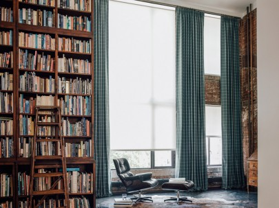 """Solar shades and tailored drapery in the library. Materials featured are """"1%"""" in white and """"Highland"""" in cove."""