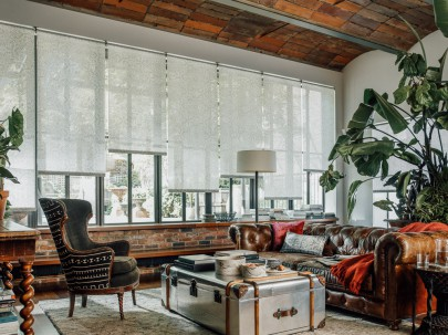 Natural roller shades in the living room.