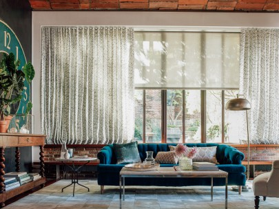 """Ripple fold drapery and solar shades in the living room. Materials featured are """"Netscape"""" in cloud and  """"3% Thermo"""" in slate."""
