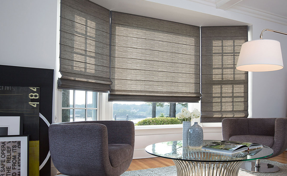 Ideas for bay window treatments the shade store for Roman shades for bay windows