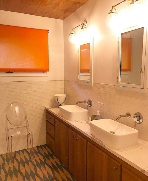 midcentury modern bathroom orange roller shade