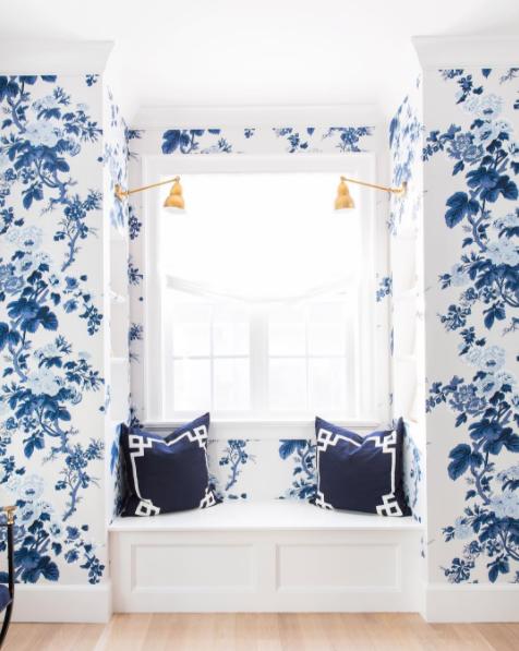 white roman shade blue wallpaper